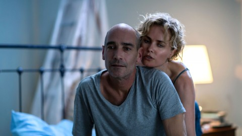 Ray-(Jean-Marc-Barr)-_-Iris-(Radha-Mitchell)-in-bed—Mark-Rogers
